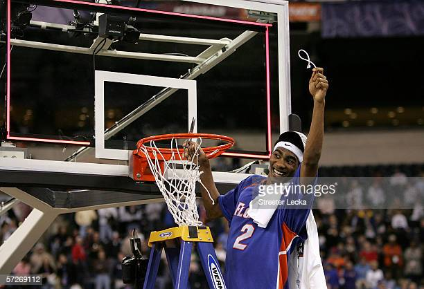 Corey Brewer of the Florida Gators celebrates by cutting down the net after defeating the UCLA Bruins during the National Championship game of the...