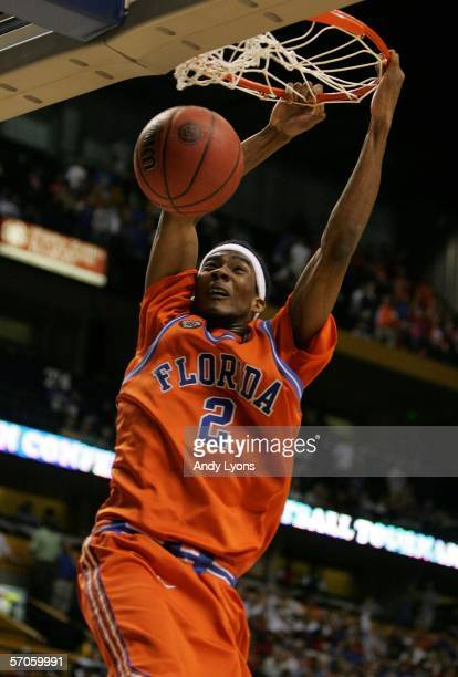 Corey Brewer of the Florida Gators dunks against the LSU Tigers during the semifinals on day 3 of the SEC Men's Basketball Conference Tournament...