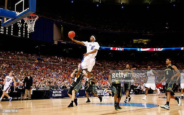 Corey Brewer of the Florida Gators goes in for a layup against the Oregon Ducks during the midwest regionals of the NCAA Men's Basketball Tournament...