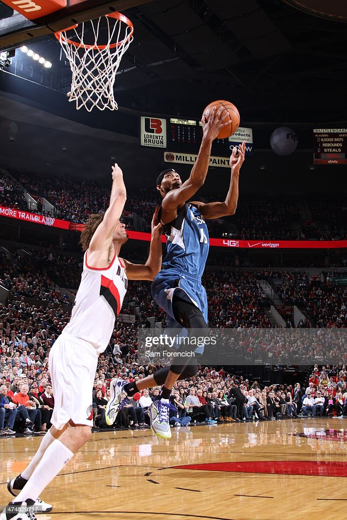 Corey Brewer #13 of the Minnesota Timberwolves drives to the basket against the Portland Trail Blazers on February 23, 2014 at the Moda Center Arena in Portland, Oregon.