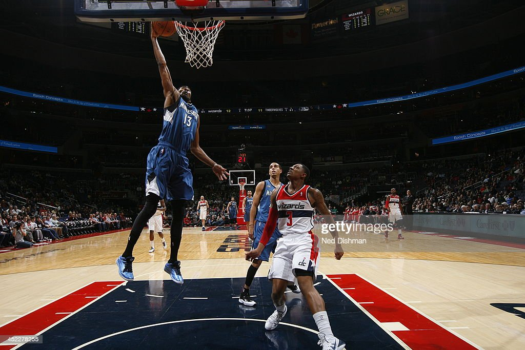 Corey Brewer #13 of the Minnesota Timberwolves goes up for the dunk against the Washington Wizards during the game at the Verizon Center on November 19, 2013 in Washington, DC.