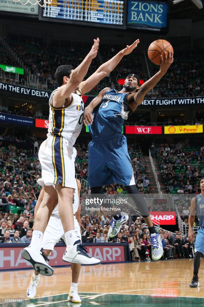 Corey Brewer #13 of the Minnesota Timberwolves shoots against Enes Kanter #0 of the Utah Jazz at EnergySolutions Arena on February 22, 2014 in Salt Lake City, Utah.