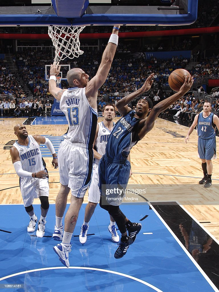 Corey Brewer #22 of the Minnesota Timberwolves shoots against Marcin Gortat #13 of the Orlando Magic on November 3, 2010 at the Amway Center in Orlando, Florida.