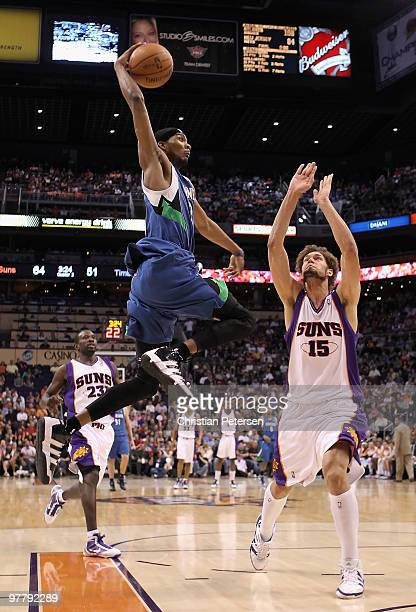 Corey Brewer of the Minnesota Timberwolves slam dunks the ball over Robin Lopez of the Phoenix Suns during the NBA game at US Airways Center on March...