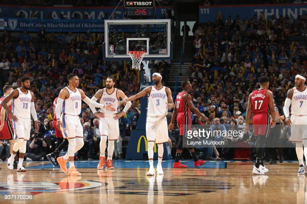Corey Brewer of the Oklahoma City Thunder and Russell Westbrook of the Oklahoma City Thunder high five during the game against the Miami Heat on...