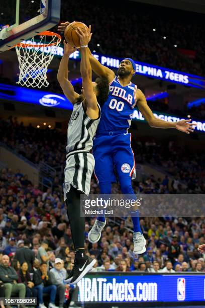 Corey Brewer of the Philadelphia 76ers fouls Derrick White of the San Antonio Spurs in the second quarter at the Wells Fargo Center on January 23...