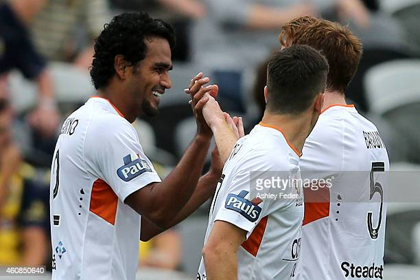 Corey Brown and Jean Carlos Solorzano of the Roar celebrate a goal with team mates during the round 13 A-League match between the Central Coast...