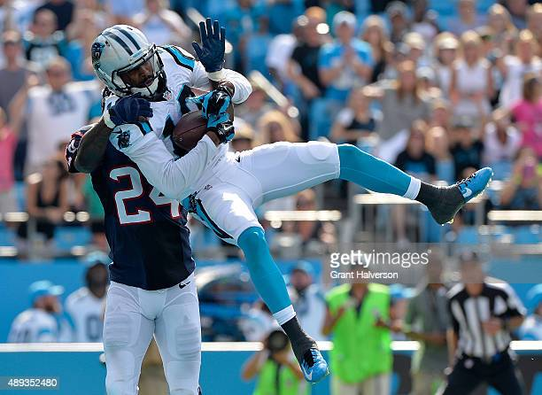 Corey Brown of the Carolina Panthers catches a fourth quarter touchdown pass against Johnathan Joseph of the Houston Texans during their game at Bank...