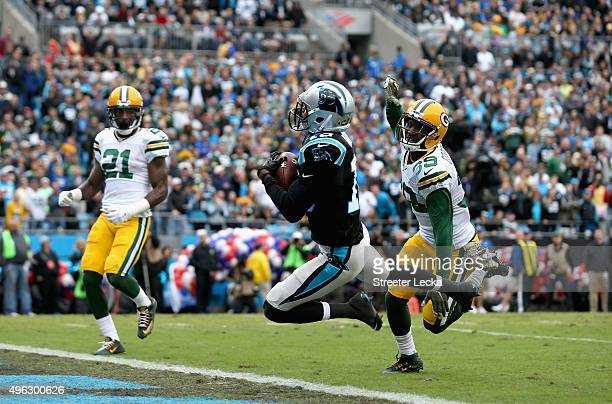 Corey Brown of the Carolina Panthers catches a touchdown pass during their game against the Green Bay Packers at Bank of America Stadium on November...