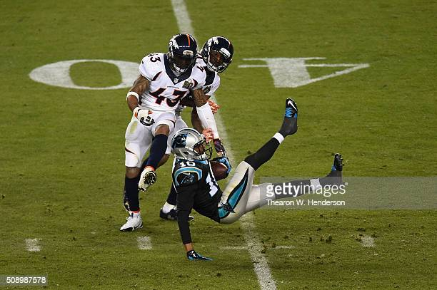 Corey Brown of the Carolina Panthers makes a 42yard catch in front of TJ Ward and Aqib Talib of the Denver Broncos during the second half of Super...