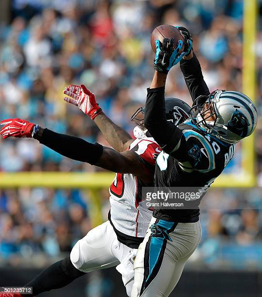 Corey Brown of the Carolina Panthers makes a catch against Phillip Adams of the Atlanta Falcons during their game at Bank of America Stadium on...