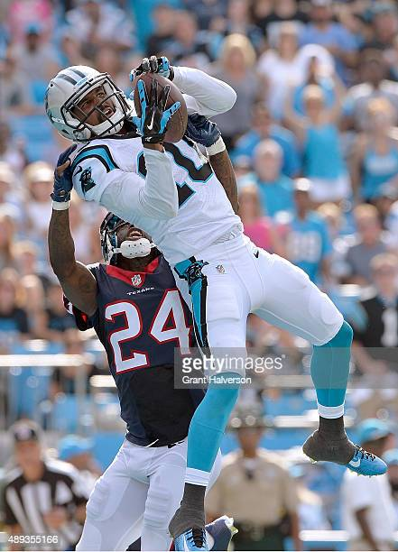 Corey Brown of the Carolina Panthers scores a touchdown against Johnathan Joseph of the Houston Texans during their game at Bank of America Stadium...