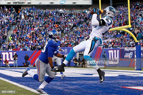 Corey Brown of the Carolina Panthers scores a touchdown in the third quarter against Trumaine McBride of the New York Giants during their game at...