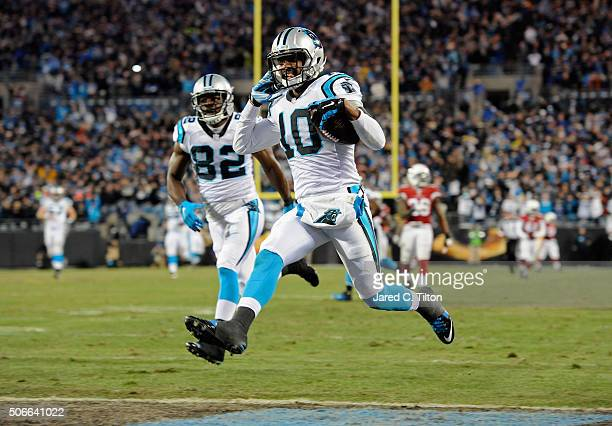 Corey Brown of the Carolina Panthers scores an 86 yard touchdown in the first quarter against the Arizona Cardinals during the NFC Championship Game...