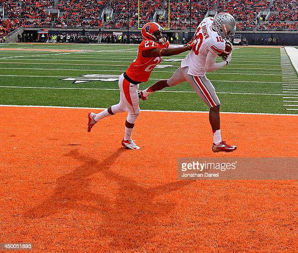 Corey Brown of the Ohio State Buckeyes catches a touchdown pass in front of Eaton Spence of the Illinois Fighting Illini at Memorial Stadium on...