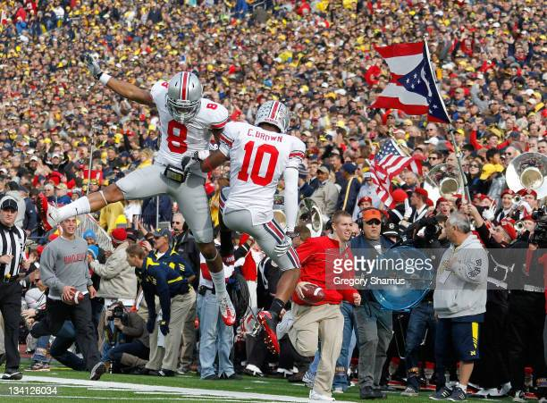 Corey Brown of the Ohio State Buckeyes celebrates his first quarter touchdown with DeVier Posey while playing the Michigan Wolverines at Michigan...