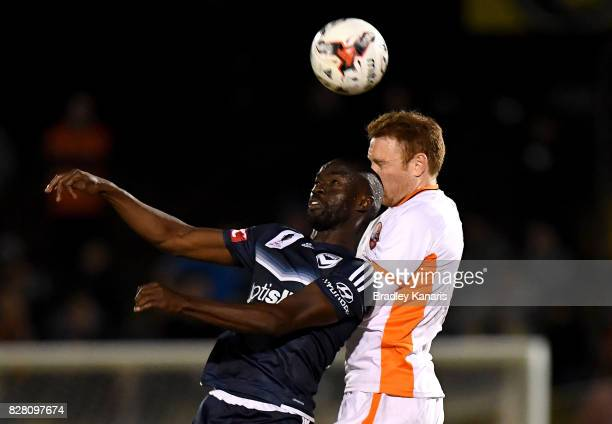 Corey Brown of the Roar and Jason Geria of the Victory challenge for the ball during the FFA Cup round of 32 match between the Brisbane Roar and the...