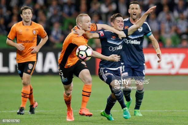 Corey Brown of the Roar and Marco Rojas of the Victory compere during the ALeague Semi Final match between Melbourne Victory and the Brisbane Roar at...