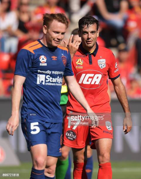 Corey Brown of the Roar and Nikola Mileusnic of United react during the round 13 ALeague match between Adelaide United and Brisbane Roar at Coopers...