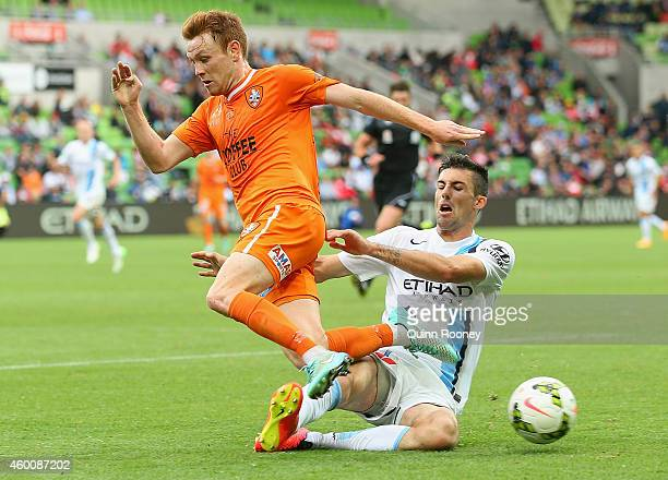 Corey Brown of the Roar is tackled by Jason Hoffman of City during the round 10 ALeague match between Melbourne City FC and Brisbane Roar at AAMI...