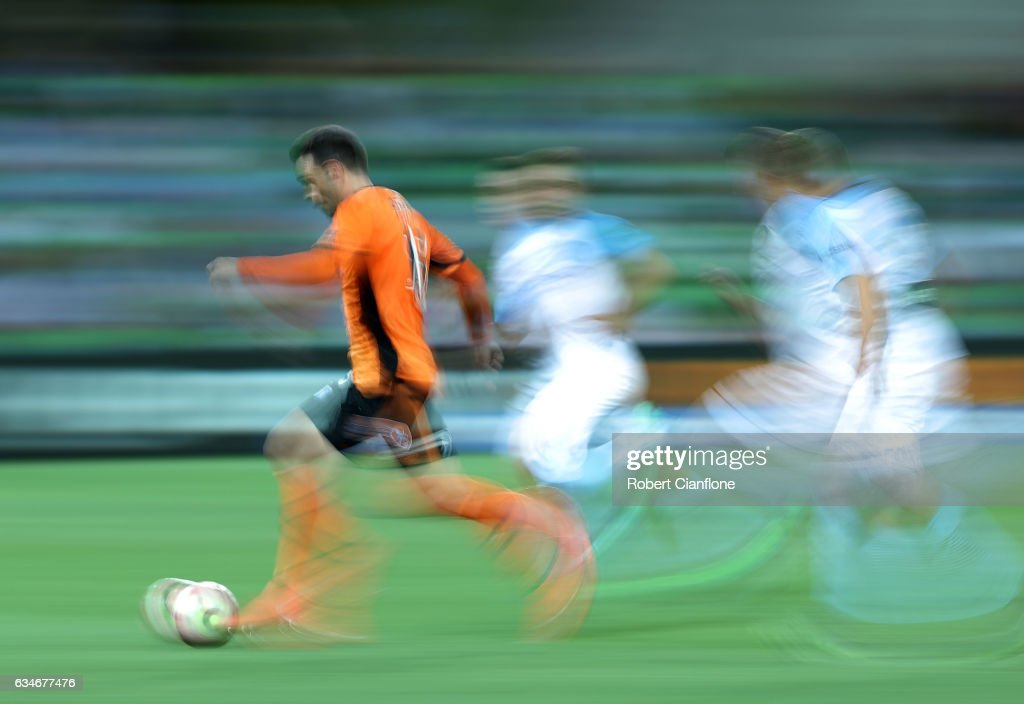 Corey Brown of the Roar runs with the ball during the round 19 A-League match between Melbourne City FC and the Brisbane Roar at AAMI Park on February 11, 2017 in Melbourne, Australia.