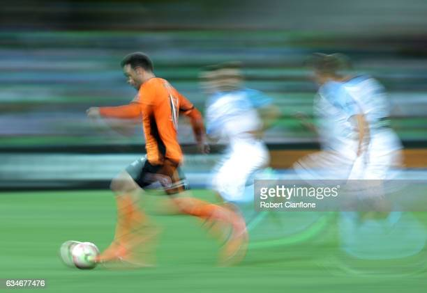Corey Brown of the Roar runs with the ball during the round 19 ALeague match between Melbourne City FC and the Brisbane Roar at AAMI Park on February...