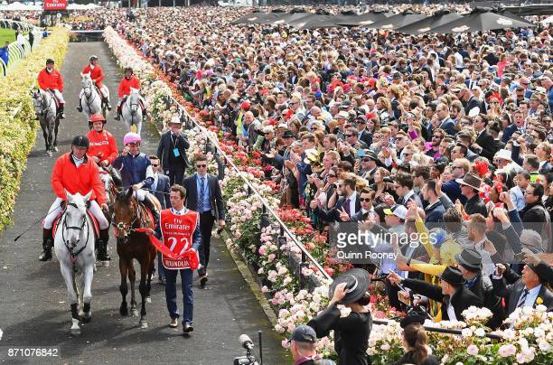 Corey Brown riding Rekindling celebrates as he returns to scale after winning race 7 the Emirates Melbourne Cup during Melbourne Cup Day at...