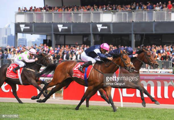 Corey Brown riding Rekindling defeats Ben Melham riding Johannes Vermeer and Zac Purton riding Max Dynamite in Race 7 Emirates Melbourne Cup during...