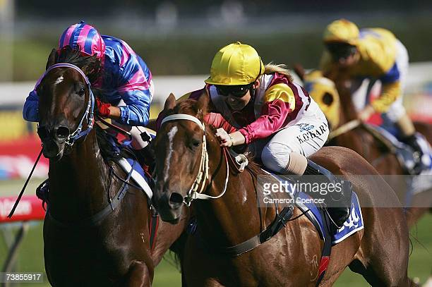 Corey Brown riding Tor's Dancer and Kathy O'Hara riding Matilda Princess come down the straight in the EQUAL Handicap during the Australian Oaks Day...