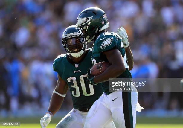 Corey Clement congratulates Wendell Smallwood of the Philadelphia Eagles after his rushing touchdown during the second half of a game against the Los...