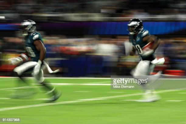 Corey Clement of the Philadelphia Eagles carries the ball against the New England Patriots in the first quarter in Super Bowl LII at US Bank Stadium...