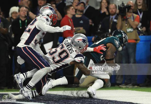 Corey Clement of the Philadelphia Eagles catches a 22 yard touchdown pass against Marquis Flowers and Patrick Chung of the New England Patriots...