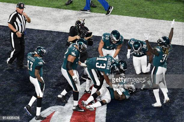 Corey Clement of the Philadelphia Eagles celebrates with teammates after a touchdown against the New England Patriots during the third quarter in...