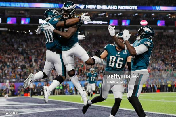 Corey Clement of the Philadelphia Eagles is congratulated by his teammate Jay Ajayi after his 22yard touchdown reception against the New England...