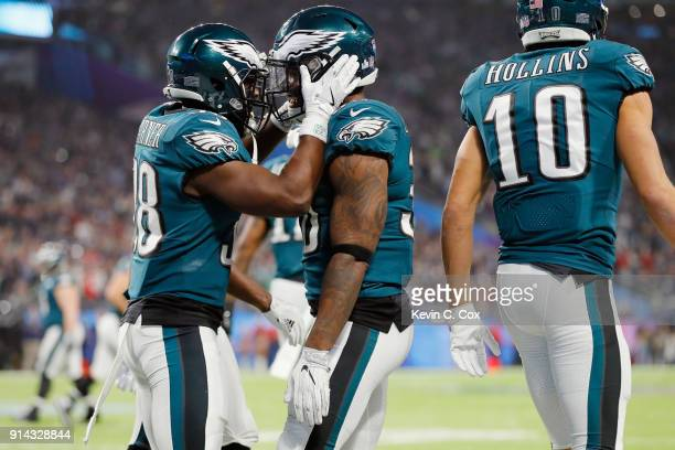 Corey Clement of the Philadelphia Eagles is congratulated by his teammate Kenjon Barner after his 22yard touchdown reception against the New England...