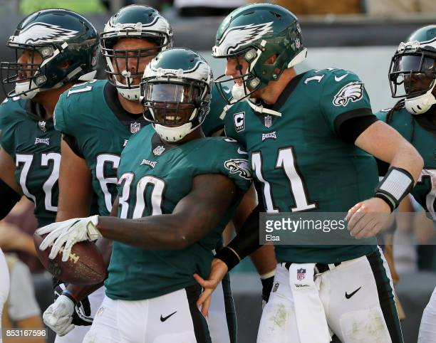 Corey Clement of the Philadelphia Eagles is congratulated by teammate Carson Wentz after Clement scored in the fourth quarter against the New York...