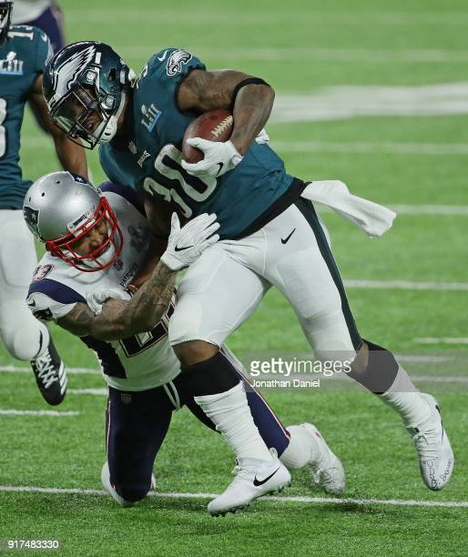 Corey Clement of the Philadelphia Eagles is hit by Patrick Chung of the New England Patriots during Super Bowl Lll at US Bank Stadium on February 4...