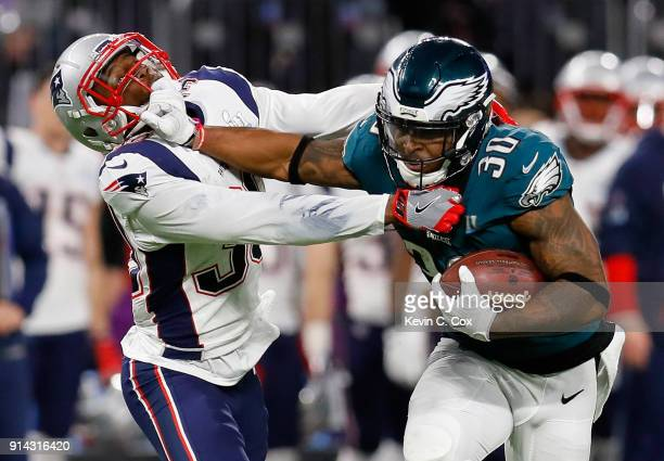 Corey Clement of the Philadelphia Eagles runs the ball past Duron Harmon of the New England Patriots for a 55yard gain during the second quarter in...