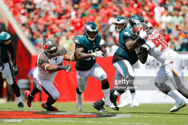 Corey Clement of the Philadelphia Eagles runs with the ball against the Tampa Bay Buccaneers during the first half at Raymond James Stadium on...