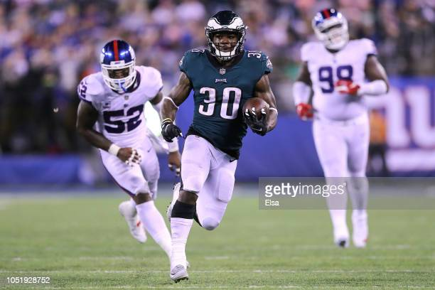 Corey Clement of the Philadelphia Eagles rushes against the New York Giants at MetLife Stadium on October 11 2018 in East Rutherford New Jersey
