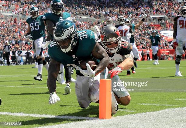 Corey Clement of the Philadelphia Eagles scores a touchdown during a game against the Tampa Bay Buccaneers at Raymond James Stadium on September 16...