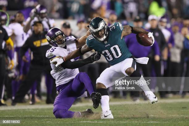 Corey Clement of the Philadelphia Eagles uses a stiff arm against Anthony Barr of the Minnesota Vikings during the second quarter in the NFC...