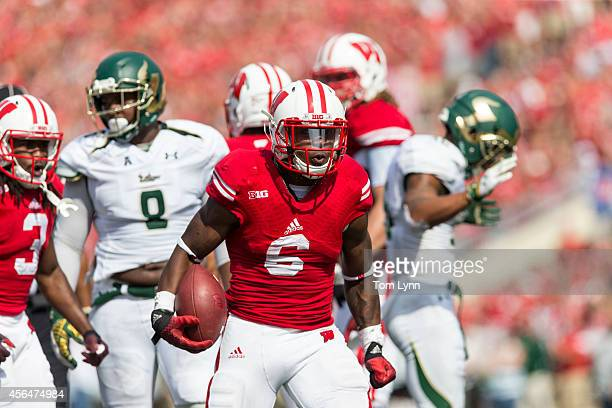 Corey Clement of the Wisconsin Badgers breaks through the South Florida Bulls defense on September 27 2014 at Camp Randall Stadium in Madison...