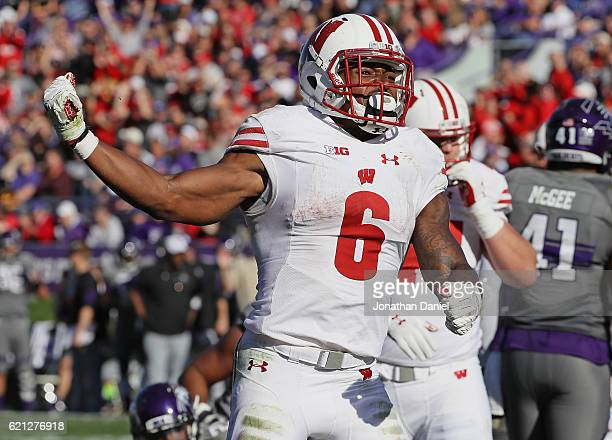 Corey Clement of the Wisconsin Badgers celebrates after socring a 4th quarter touchdown against the Northwestern Wildcats at Ryan Field on November 5...