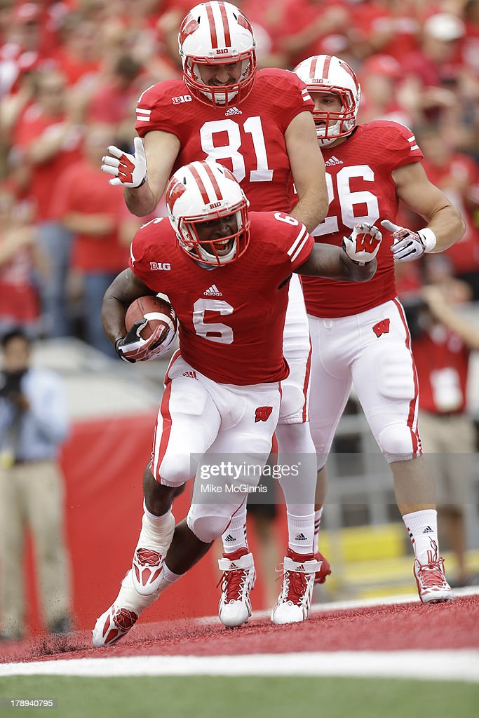 Corey Clement #6 of the Wisconsin Badgers celebrates with Brock DeCicco #81 after making a touchdown during the game against the UMass Minutemen at Camp Randall Stadium on August 31, 2013 in Madison, Wisconsin.