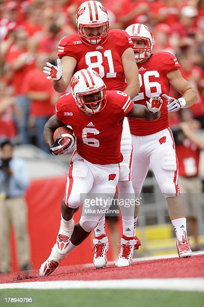 Corey Clement of the Wisconsin Badgers celebrates with Brock DeCicco after making a touchdown during the game against the UMass Minutemen at Camp...