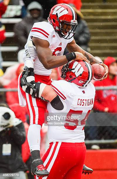 Corey Clement of the Wisconsin Badgers celebrates with Kyle Costigan after scoring a touchdown in the second quarter at High Point Solutions Stadium...