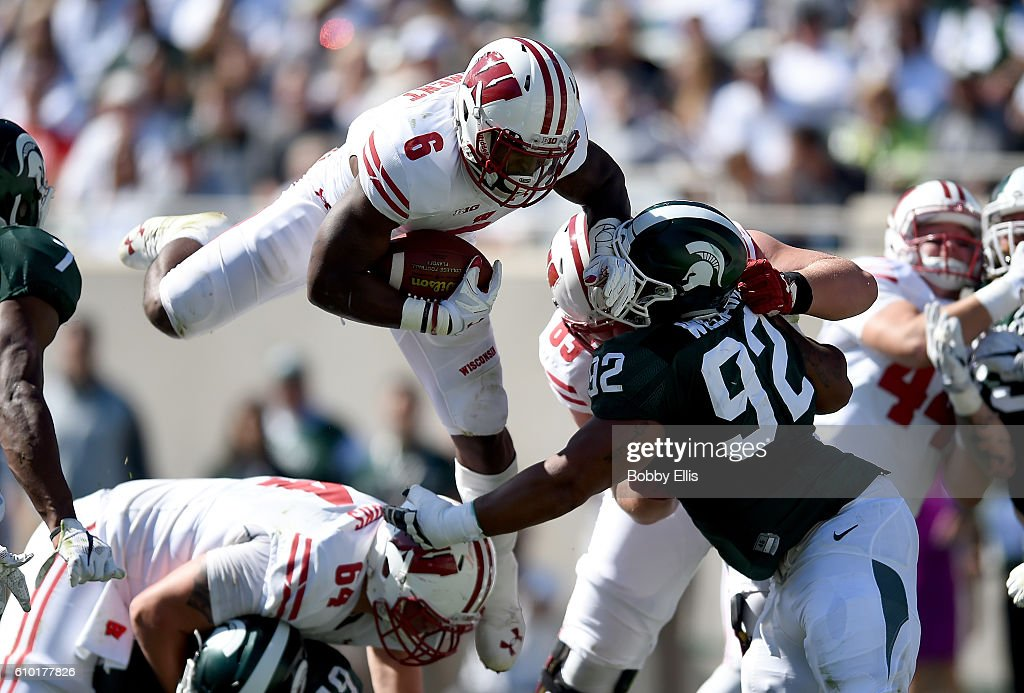 Corey Clement #6 of the Wisconsin Badgers hurtles a player during the game against the Michigan State Spartans at Spartan Stadium on September 24, 2016 in East Lansing, Michigan.
