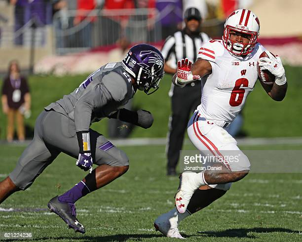 Corey Clement of the Wisconsin Badgers is pursued by Kyle Queiro of the Northwestern Wildcats at Ryan Field on November 5 2016 in Evanston Illinois