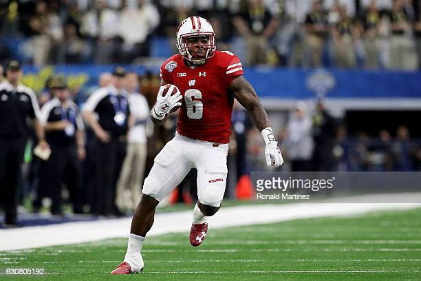 Corey Clement of the Wisconsin Badgers runs during the 81st Goodyear Cotton Bowl Classic between Western Michigan and Wisconsin at ATT Stadium on...